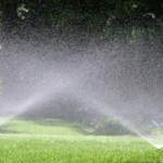 watering grass with sprinkler system